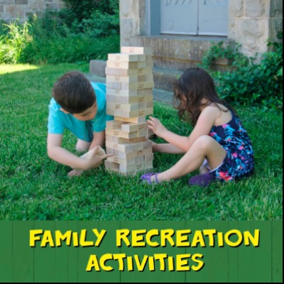 young children playing with a giant Jenga game