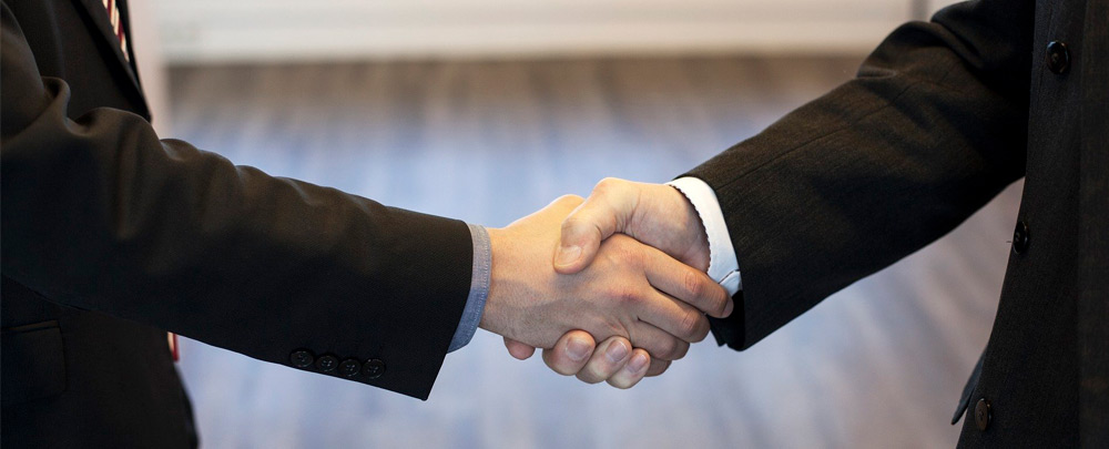 closeup of shaking hands in a business agreement